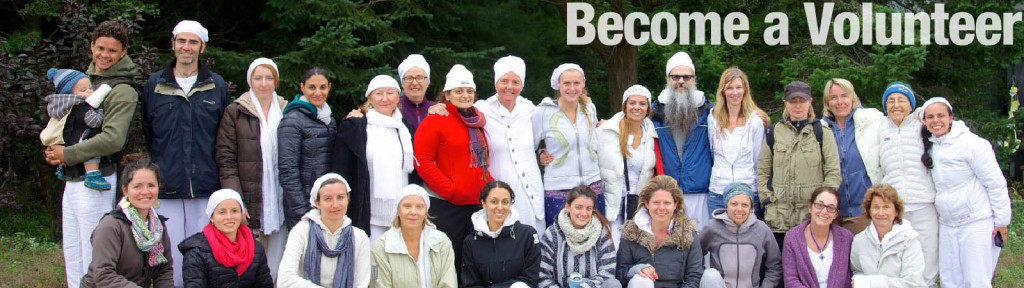 Become a Volunteer and Work with Toronto Kundalini Yoga - A group photo of 30 people who voluneer around the community.
